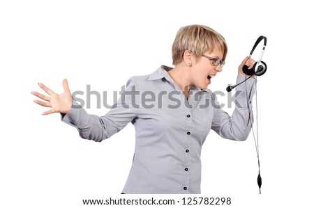 angry shouts into microphone operator - stock photo