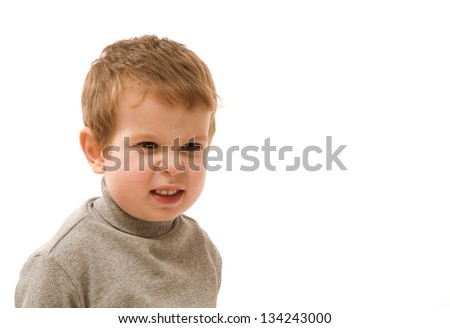 Angry small boy over white background - stock photo