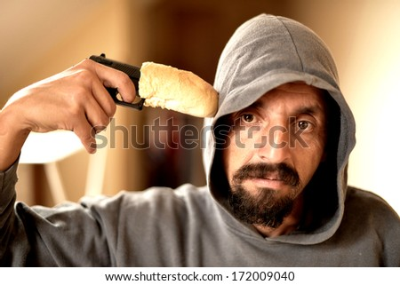 Angry Soldier Holding Gun. Humour. - stock photo