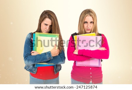 Angry students over ocher background - stock photo