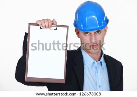 Angry surveyor holding clipboard - stock photo