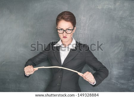 http://thumb1.shutterstock.com/display_pic_with_logo/649624/149328884/stock-photo-angry-teacher-in-glasses-with-wooden-stick-149328884.jpg
