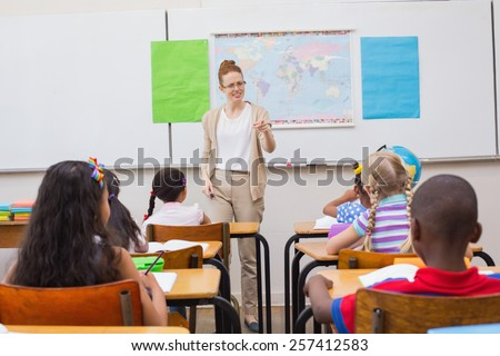 Angry teacher looking pupil at the elementary school