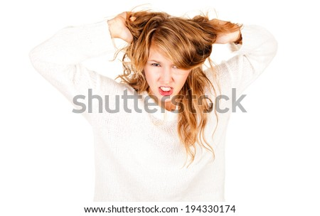 angry teen girl looking at the camera, white background - stock photo