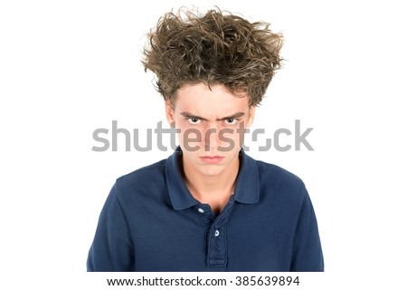 Angry teenage boy with crazy hair isolated in white - stock photo