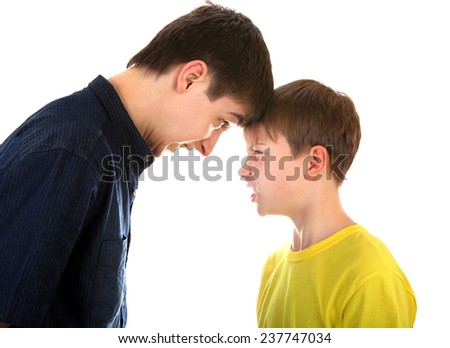 Angry Teenager and Kid looking to each other on the White Background