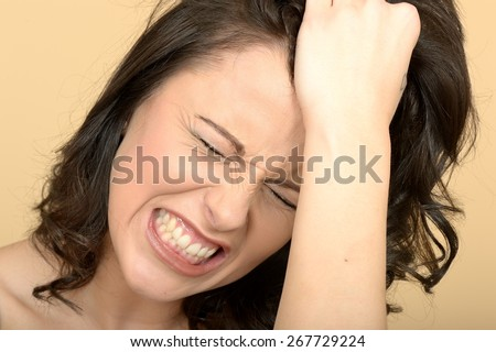 Angry Tense Attractive Young Woman Looking Stressed in a Tantrum - stock photo