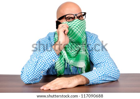 Angry terrorist negotiate over the phone - stock photo