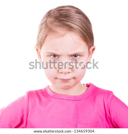 Angry unhappy little girl isolated on white background - stock photo