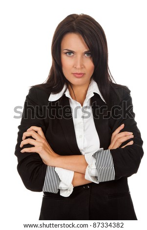 Angry upset business woman standing with folded hands. Isolated over white background