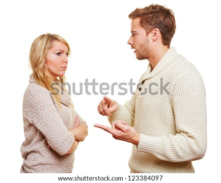 Angry wan discussing with his woman in a relationship