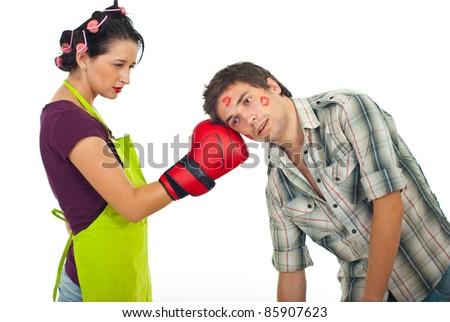 Angry wife boxing unfaithful husband isolated on white background - stock photo