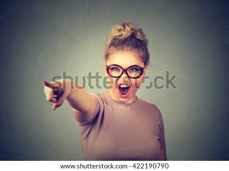Angry woman accusing someone screaming pointing with finger  - stock photo