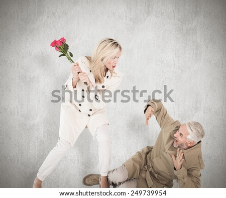 Angry woman attacking partner with rose bouquet against white background - stock photo