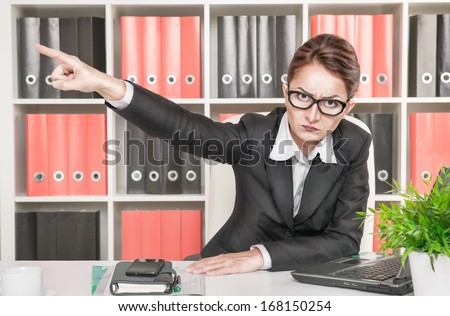 Angry woman boss pointing out - stock photo