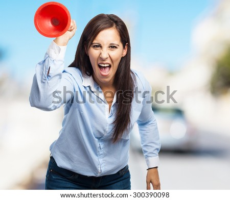 angry woman holding a plunger - stock photo