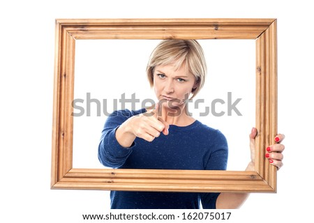 Angry woman holding the wooden picture frame