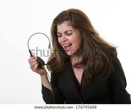 Angry woman in call center shouting at the guest or client - stock photo