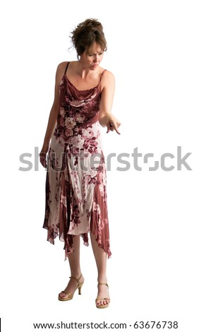 Angry woman pointing her finger down as she has a scolding look upon her face. - stock photo