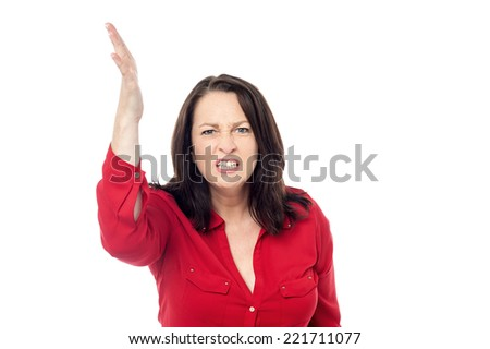 Angry woman raise hand about to slap