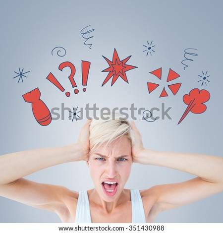 Angry woman screaming and holding her head against grey vignette - stock photo