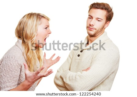 Angry woman screaming at man in a discussion - stock photo