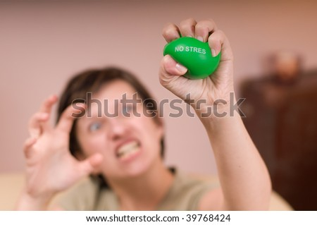 angry woman squeezes the ball - stock photo