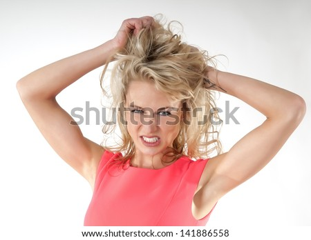 angry woman tearing hair - stock photo