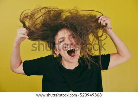angry woman tearing hair on his head