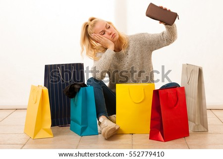 Angry woman with shopping bags after shopping as she spent all t