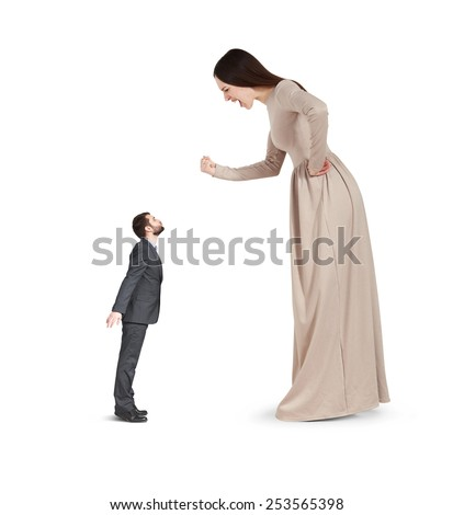 angry yelling woman waving fist and looking at small kissing man. isolated on white background - stock photo