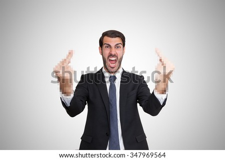 Angry young business man showing censored fingers at camera. - stock photo