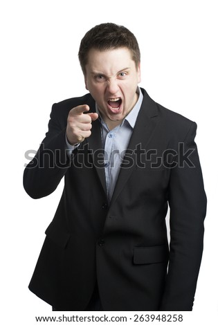 Angry young businessman pointing with his finger and giving out orders. Motivation gesture.  - stock photo