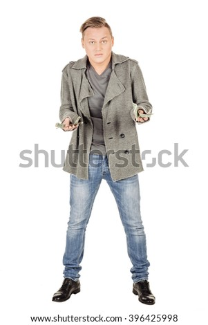 angry young man holding Money Cash Dollars in hands. Negative human emotions facial expression feelings attitude. Concept of finance crisis. isolated on white background
