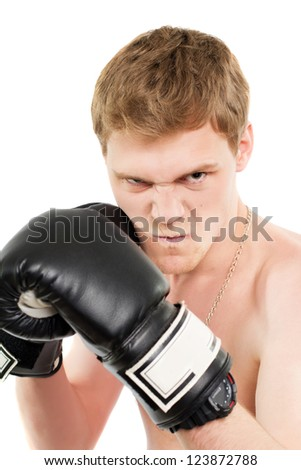 Angry young man in boxing gloves. Isolated - stock photo