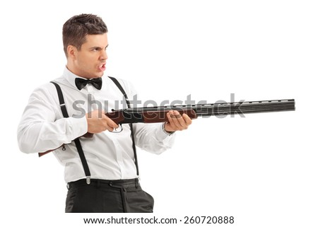 Angry young man shooting with a shotgun isolated on white background - stock photo