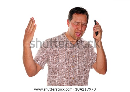 Angry young man yelling at phone at cell phone call - stock photo