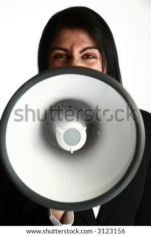 Angry young middle eastern woman yelling into bullhorn, megaphone. - stock photo