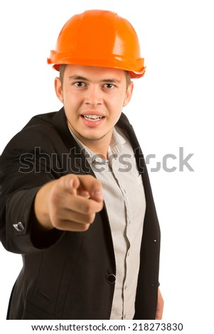 Angry young structural engineer or architect in a hardhat and suit with a stern expression glaring and pointing his finger at the camera, upper body on white - stock photo