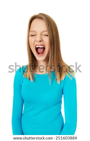 Angry young teen woman screaming  - stock photo