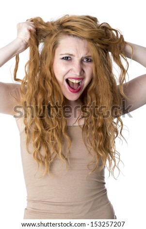 Angry Young Woman Tearing Hair Out