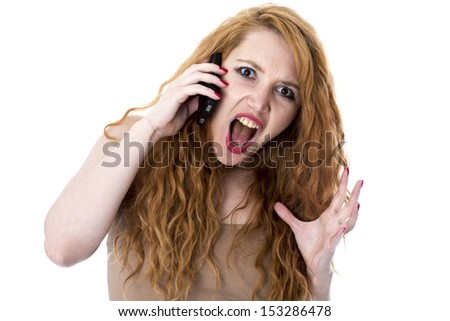 Angry Young Woman Using Mobile Telephone