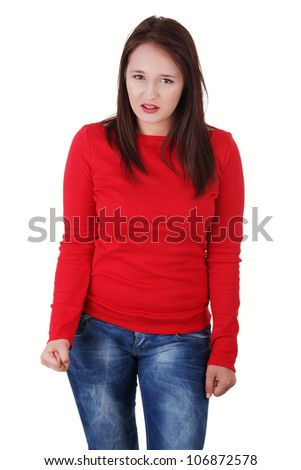 Angry young woman wearing red blouse is clenching fists. Isolated on white background. - stock photo