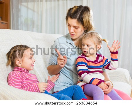 Angry young woman with child on arms shaming another girl
