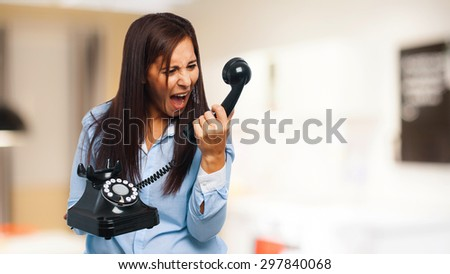 angry young-woman with telephone - stock photo