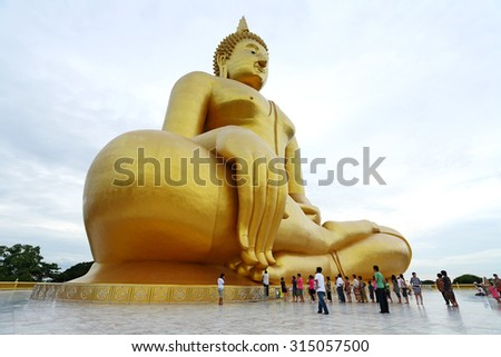 ANGTHONG, THAILAND - JUL 25: Unidentified people go to pray for big statue of buddha at Wat muang on July 25, 2010 in Angthong. It is a buddha statue sitting largest in Thailand - stock photo
