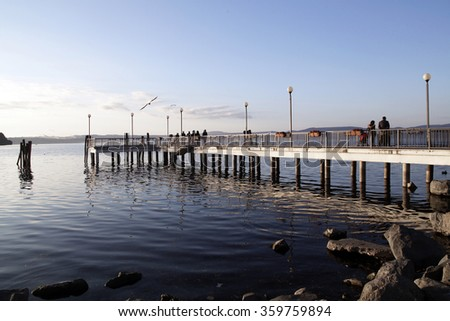ANGUILLARA SABAZIA, ITALY - DECEMBER 12 2015: scenic view of dock on the lake Bracciano seen from Anguillara Sabazia a picturesque and touristic village near Rome, Italy