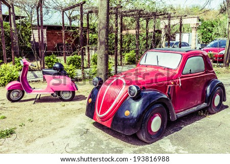 ANGUILLARA SABAZIA, LAZIO, ITALY - APRIL 6, 2014: Nice model of the old Fiat 500 Topolino. The Fiat 500, commonly known as Topolino, is an Italian automobile model manufactured by Fiat. - stock photo