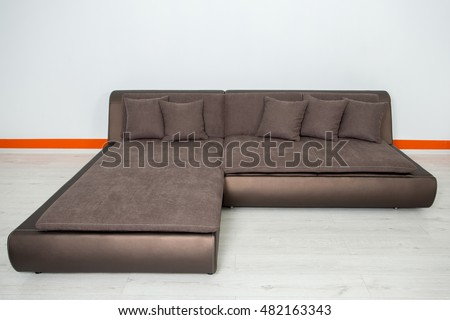 angular brown leather sofa on a white background