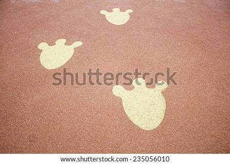 Animal Footprints in playground, decoration and leisure - stock photo